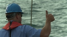 Hand signals are used between the launch supervisor and winch operator duringover-the-side oceanographic operations.
