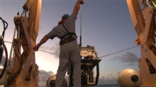 Launching Seirios from the stern of the OKEANOS EXPLORER.  The boatswain issignaling to lower away.