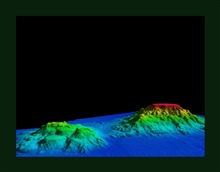 3-D view of Giacomini and Ely Seamounts in the Gulf of Alaska shows the ruggedflanks and flat tops typical of seamounts in this area.