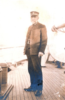 Captain John J. Gilbert on the decks of the Coast and Geodetic Survey ShipPATHFINDER in San Francisco Harbor in winter 1900-1901.