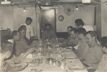 Wardroom of USC&GS; Ship PATHFINDER with Executive Officer JosephPartington at head of table.