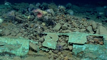Artifact from Monterrey C shipwreck. Copper-sheathed stern, bottles, andballast stones.