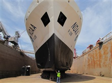 NOAA Ship PISCES in drydock looking bow on.