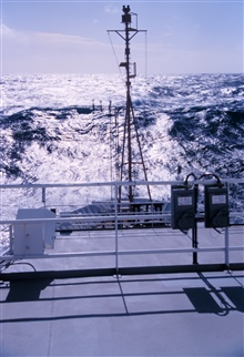The bow of the NOAA Ship RONALD H. BROWN headed into North Pacific swells.