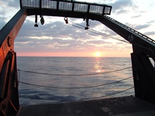 Sunset framed in the A-Frame of the NOAA Ship NANCY FOSTER