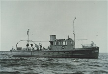 The Coast and Geodetic Survey Ship WAINWRIGHT conducting wire drag operations.