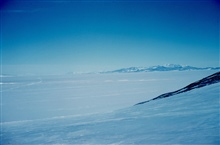 The trail of the tractor-train receding far into the  distance.McMurdo Station to South Pole traverse