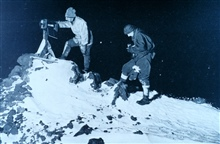 Dr. Wilson and Lieut. Bowers reading the ramp thermometer in the winter night,-40 Fahr.  (A flashlight photograph.)In:  Scott's Last Expedition ...., 1913.  Dodd, Mead, and Company.  New York.Volume I.  Page 221.