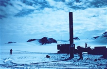 Large stand built of welded fuel barrels set as navigation aid on way to SouthPole.  McMurdo Station to South Pole traverse