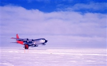 Ski-equipped C-130 taking off from the South Pole