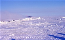 The last plane at South Pole Station taking off before the fall sunset