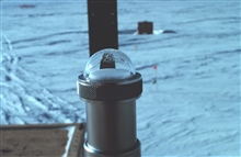 Ultraviolet pyrometer mounted on the roof of the Clean Air Facility.