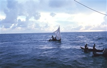 Native Micronesian fishermen greeting the TOWNSEND CROMWELLFew Micronesians use traditional sailing outrigger canoes today.