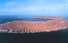 Half rim of volcanic crater. Unidentified island.